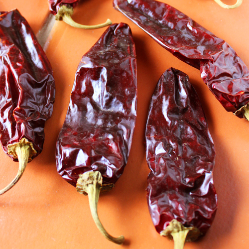 red-chiles-on-terra-cotta