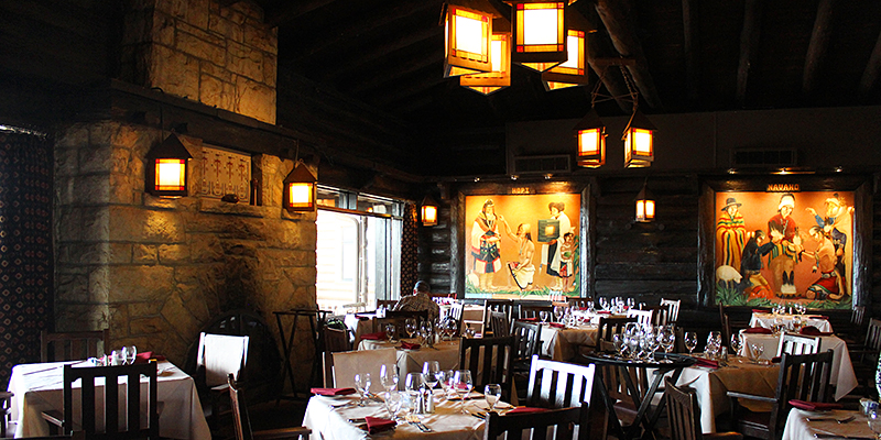 This is the main dining area with the fireplace made of native stone   flanked by large windows facing the canyon. Dining 20 Ft  From The Rim Of The Grand Canyon    El Tovar