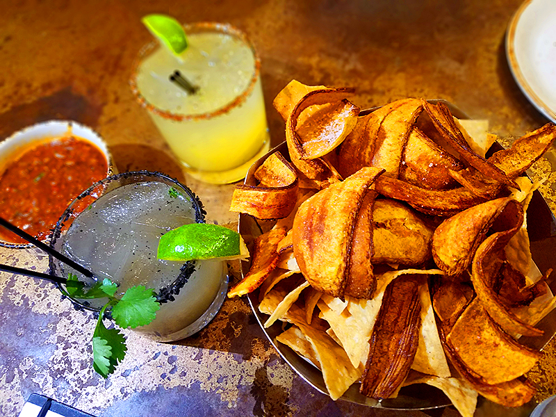 Plantain chips salsa and drinks